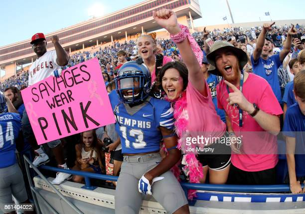 Kedarian Jones of the Memphis Tigers celebrates with fans after the game against the Navy Midshipmen on October 14 2017 at Liberty Bowl Memorial...