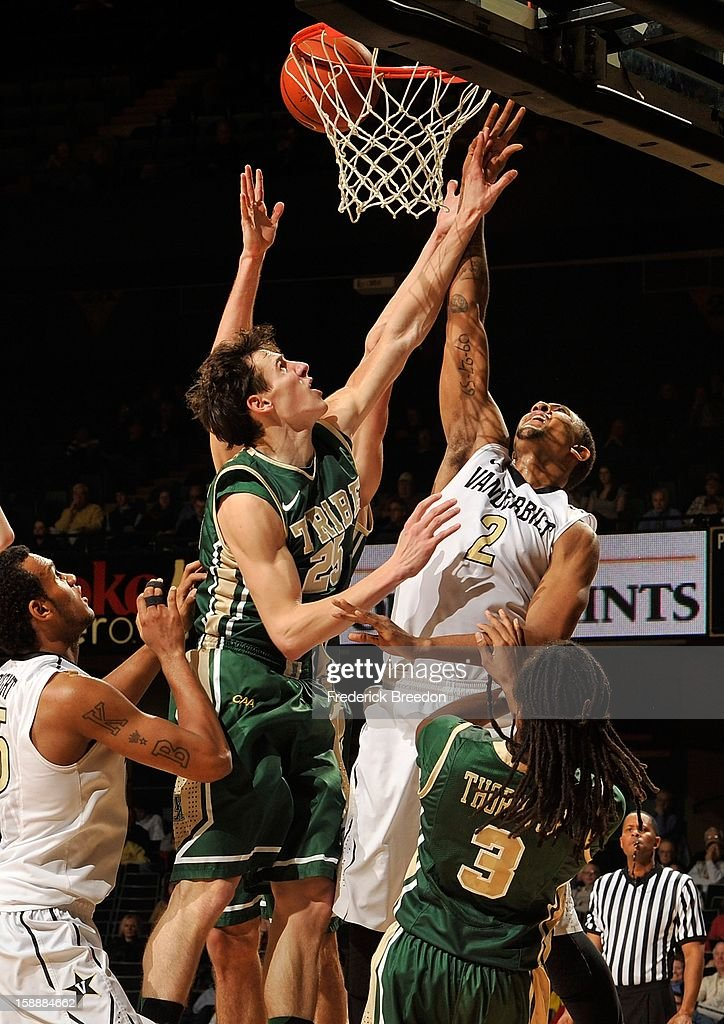 Kedren Johnson #2 of the Vanderbilt Commodores and Terry Tarpey #25 of William & Mary jump for a rebound at Memorial Gym on January 2, 2013 in Nashville, Tennessee.