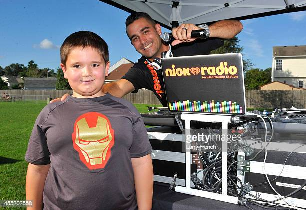 Keegan Boyle makes an announcement with J Boogie at Nickelodeon's Road To Worldwide Day of Play on September 10 2014 in Virginia Beach Virginia