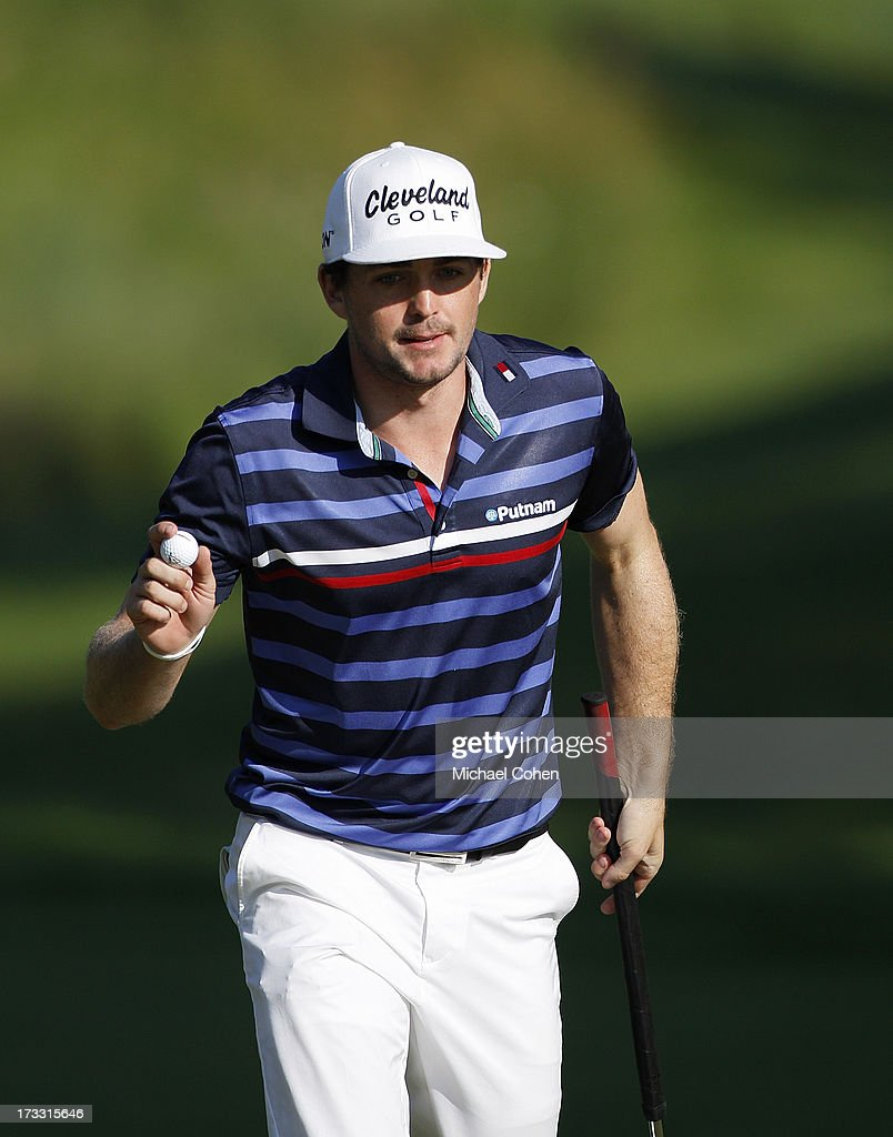 <a gi-track='captionPersonalityLinkClicked' href=/galleries/search?phrase=Keegan+Bradley&family=editorial&specificpeople=6388440 ng-click='$event.stopPropagation()'>Keegan Bradley</a> acknowledges the gallery during the first round of the John Deere Classic held at TPC Deere Run on July 11, 2013 in Silvis, Illinois.