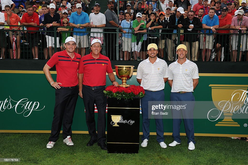 Keegan Bradley and Phil Mickelson of the U.S. Team pose for a photo with Jason Day and Graham DeLaet of the International Team on the first hole during the Day Three Foursome Matches at the Muirfield Village Golf Club on October 5, 2013 in Dublin, Ohio.
