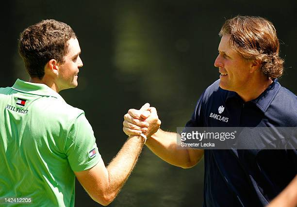 Keegan Bradley and Phil Mickelson shake hands during the Par 3 Contest prior to the start of the 2012 Masters Tournament at Augusta National Golf...