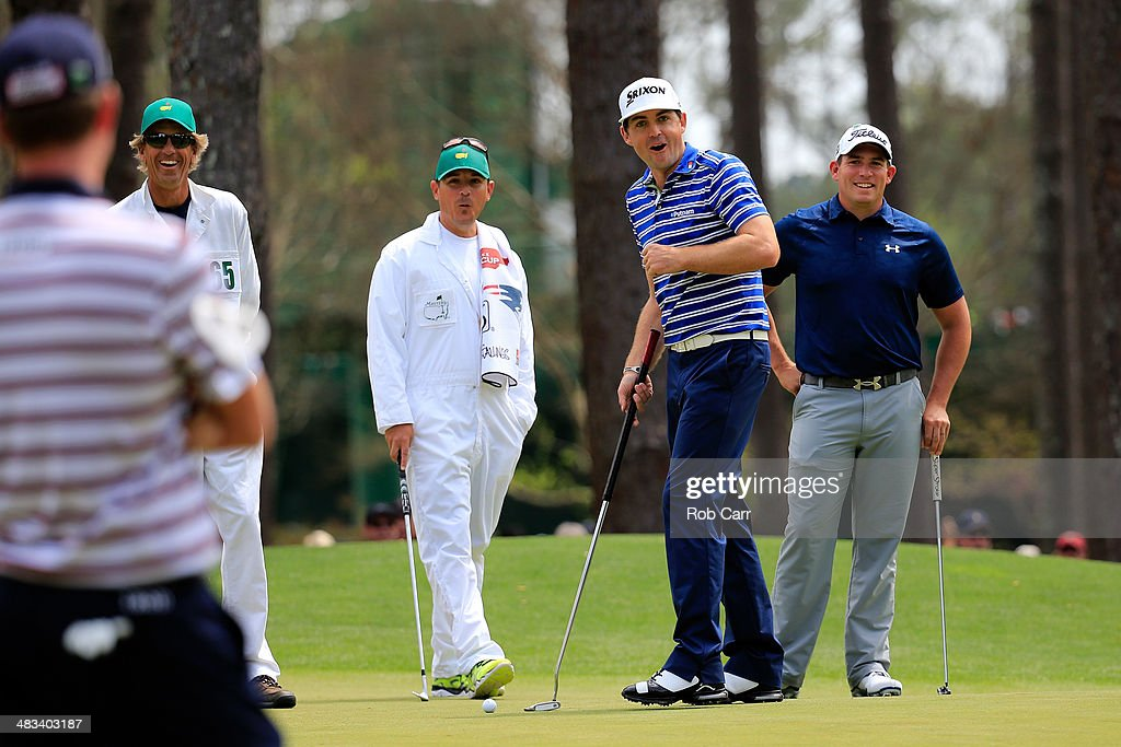 Keegan Bradley and Scott Stallings of the United States look over a green during a practice round prior to the start of the 2014 Masters Tournament at Augusta National Golf Club on April 8, 2014 in Augusta, Georgia.