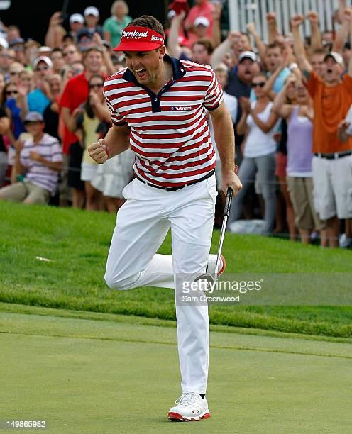 Keegan Bradley celebrates a par putt on the 18th green on his way to winning the World Golf ChampionshipsBridgestone Invitational at Firestone...