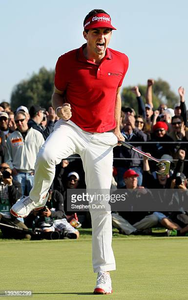 Keegan Bradley celebrates after making a birdie putt to put him in a three way playoff during the final round of the Northern Trust Open at Riviera...