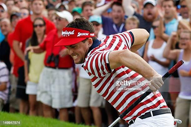 Keegan Bradley celebrates his par putt on the 18th green on his way to winning the final round of the World Golf ChampionshipsBridgestone...