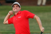 Keegan Bradley celebrates his victory over Jason Dufner on the third playoff hole during the final round of the 93rd PGA Championship at the Atlanta...