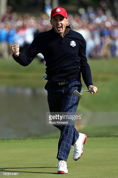 Keegan Bradley celebrates on the 15th green after he made birdie to defeat the team of Donald/Garcia 43 during the Morning Foursome Matches for The...