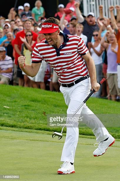 Keegan Bradley celebrates on the 18th green on his way to winning the final round of the World Golf ChampionshipsBridgestone Invitational at...