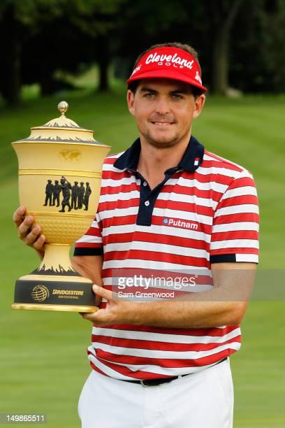 Keegan Bradley celebrates with the Gary Player trophy during the trophy presentation after winning the World Golf ChampionshipsBridgestone...