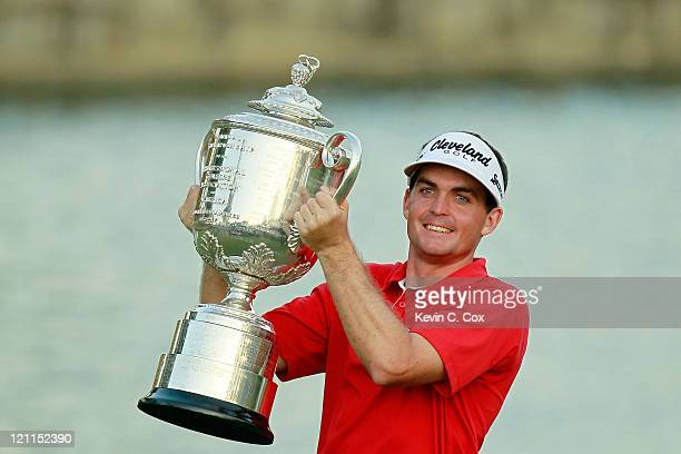 Keegan Bradley celebrates with the Wanamaker Trophy after winning a threehole playoff over Jason Dufner during the final round of the 93rd PGA...