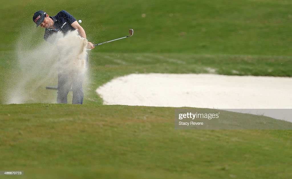 Keegan Bradley chips out of the bunker on the 2nd during Round Three of the Zurich Classic of New Orleans at TPC Louisiana on April 26 2014 in...