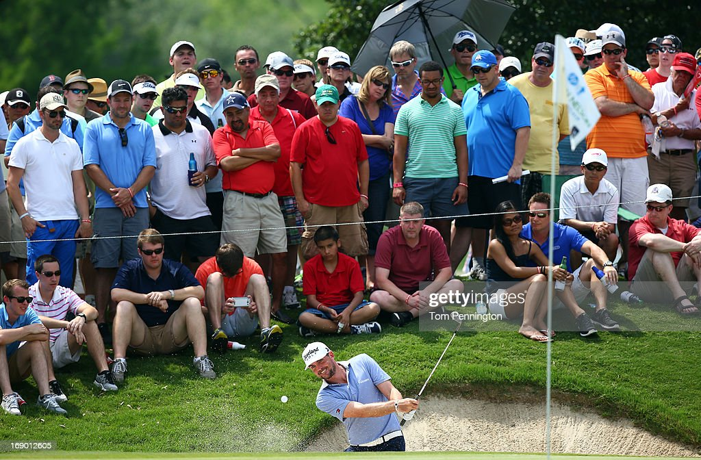 Keegan Bradley hits a shot out of a sand trap during the third round of the 2013 HP Byron Nelson Championship at the TPC Four Seasons Resort on May...