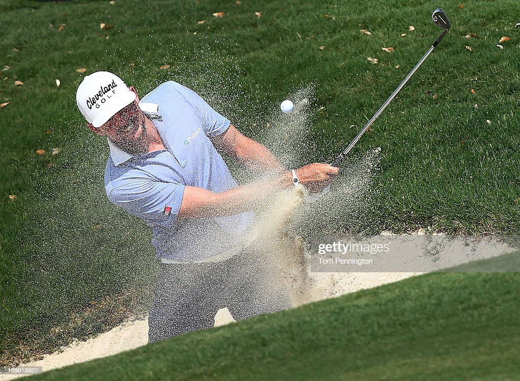 Keegan Bradley hits a shot out of a sand trap during the third round of the 2013 HP Byron Nelson Championship at the TPC Four Seasons Resort on May 18, 2013 in Irving, Texas.