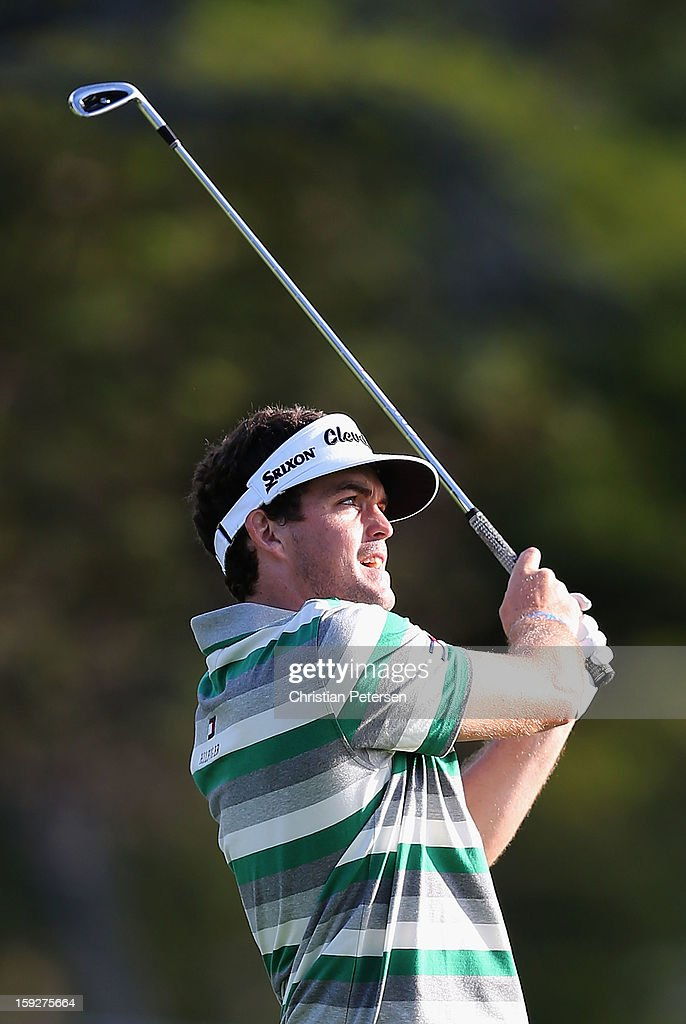 <a gi-track='captionPersonalityLinkClicked' href=/galleries/search?phrase=Keegan+Bradley&family=editorial&specificpeople=6388440 ng-click='$event.stopPropagation()'>Keegan Bradley</a> hits his second shot on the 13th hole during the first round of the Sony Open in Hawaii at Waialae Country Club on January 10, 2013 in Honolulu, Hawaii.