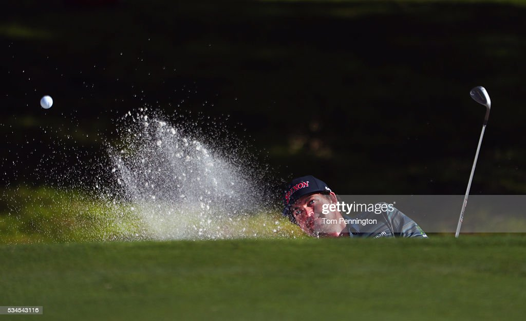 Keegan Bradley hits out of the trap on the seventh hole during the First Round of the DEAN & DELUCA Invitational at Colonial Country Club on May 26, 2016 in Fort Worth, Texas.