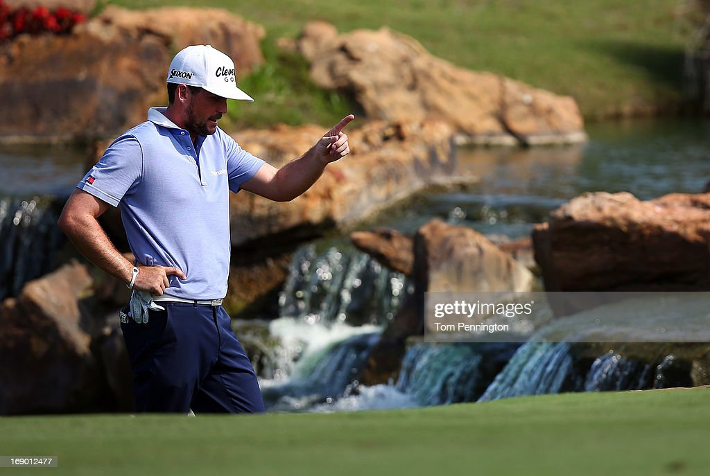 Keegan Bradley inspects his lie after hitting in the rough on the 18th fairway during the third round of the 2013 HP Byron Nelson Championship at the TPC Four Seasons Resort on May 18, 2013 in Irving, Texas.