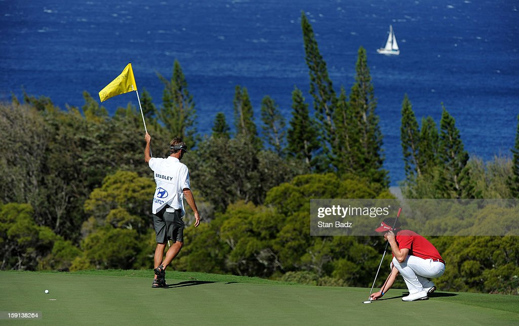 Keegan Bradley lines his ball on the 13th green during the final round of the Hyundai Tournament of Champions at Plantation Course at Kapalua on January 8, 2013 in Kapalua, Maui, Hawaii.
