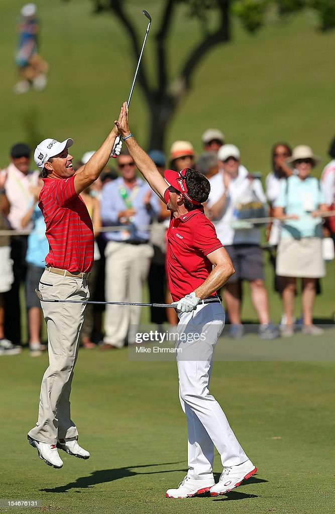 <a gi-track='captionPersonalityLinkClicked' href=/galleries/search?phrase=Keegan+Bradley&family=editorial&specificpeople=6388440 ng-click='$event.stopPropagation()'>Keegan Bradley</a> of the United States and <a gi-track='captionPersonalityLinkClicked' href=/galleries/search?phrase=Padraig+Harrington&family=editorial&specificpeople=175865 ng-click='$event.stopPropagation()'>Padraig Harrington</a> of Ireland react to holing out for eagle on the 14th hole during the final round of the PGA Grand Slam of Golf at Port Royal Golf Course on October 24, 2012 in Southampton, Bermuda.