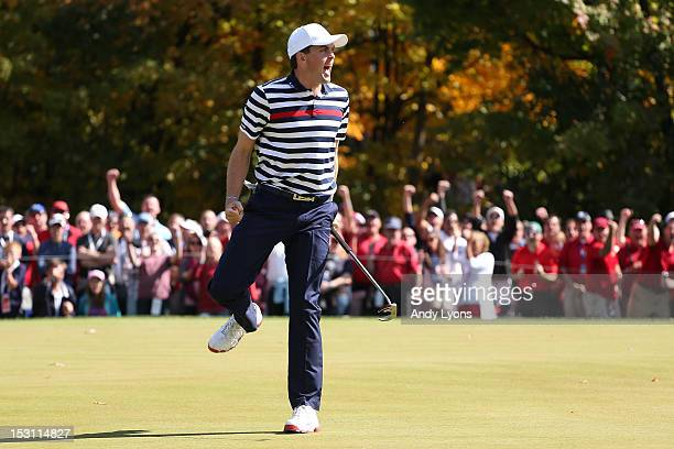 Keegan Bradley of the United States celebrates his birdie putt on the fifth green during the Singles Matches for The 39th Ryder Cup at Medinah...