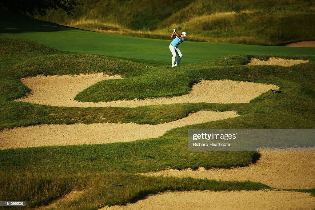 Keegan Bradley of the United States hits his second shot on the 18th hole during the continuation of the weather-delayed second round of the 2015 PGA Championship at Whistling Straits on August 15, 2015 in Sheboygan, Wisconsin.