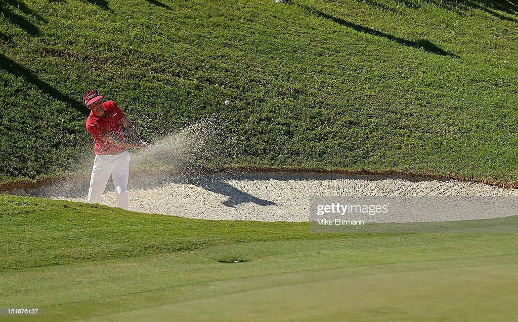 Keegan Bradley of the United States hits out of the bunker on the 17th hole during the final round of the PGA Grand Slam of Golf at Port Royal Golf Course on October 24, 2012 in Southampton, Bermuda.