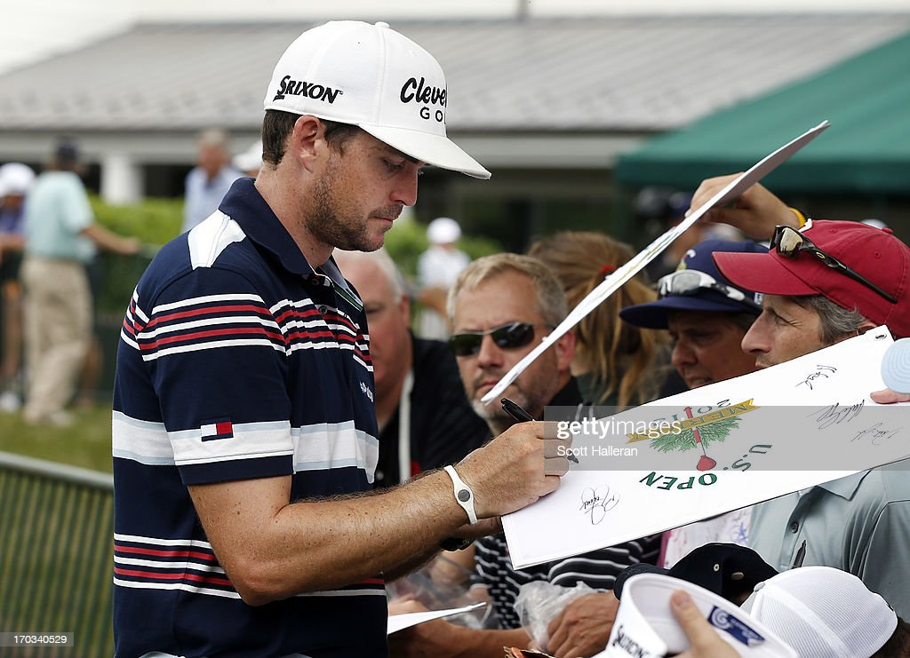 Keegan Bradley of the United States signs his autograph for fans during a practice round prior to the start of the 113th U.S. Open at Merion Golf Club on June 11, 2013 in Ardmore, Pennsylvania.
