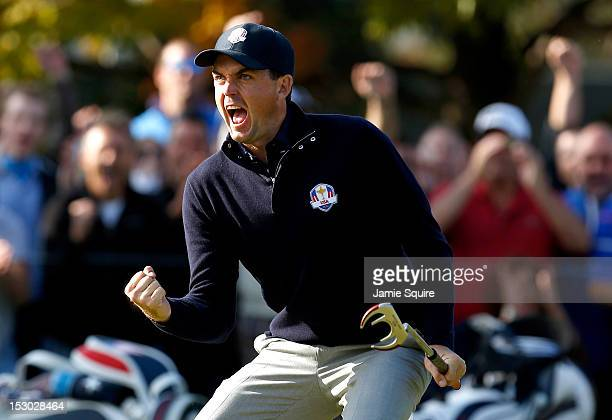 Keegan Bradley of the USA celebrates a birdie putt on the ninth green during day two of the Morning Foursome Matches for The 39th Ryder Cup at...