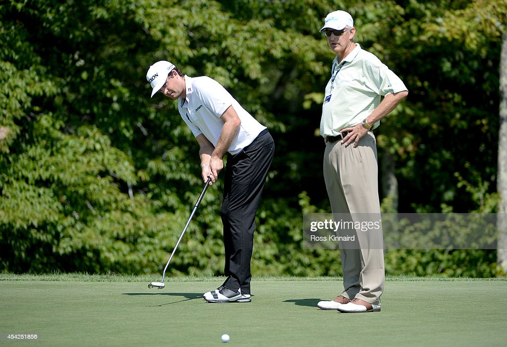 Keegan Bradley of the USA watched by Andy North during a practice round prior to the Deutsche Bank Championship at TPC Boston on August 27, 2014 in Norton, Massachusetts.