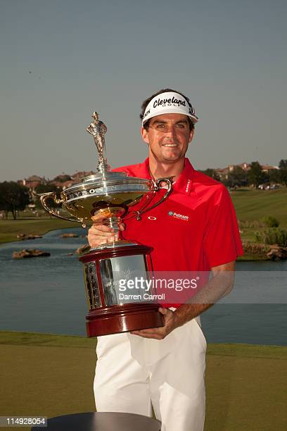 Keegan Bradley poses with the champion's trophy following his victory at the HP Byron Nelson Championship at TPC Four Seasons at Las Colinas on May...