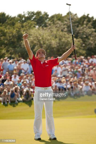 Keegan Bradley raises his arms to celebrate his victory at the HP Byron Nelson Championship at TPC Four Seasons at Las Colinas on May 29 2011 in...