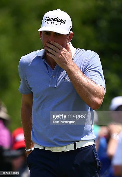 Keegan Bradley reacts to a missed birdie putt during the third round of the 2013 HP Byron Nelson Championship at the TPC Four Seasons Resort on May...
