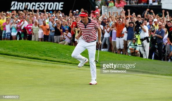 Keegan Bradley reacts to a par putt on the 18th green on his way to winning the final round of the World Golf ChampionshipsBridgestone Invitational...