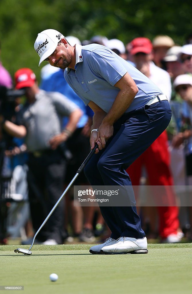 Keegan Bradley reacts to a putt during the third round of the 2013 HP Byron Nelson Championship at the TPC Four Seasons Resort on May 18 2013 in...
