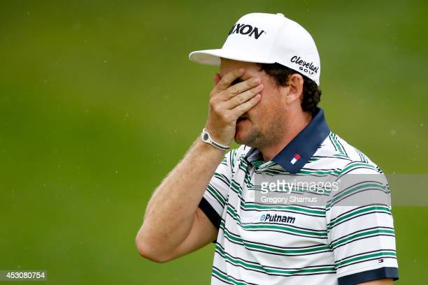 Keegan Bradley reacts to a putt on the 18th green during the third round of the World Golf ChampionshipsBridgestone Invitational at Firestone Country...