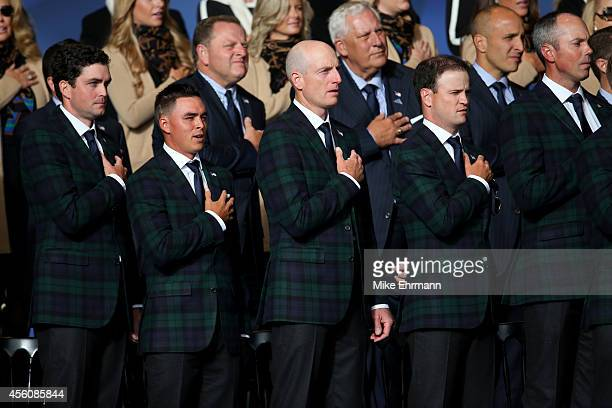 Keegan Bradley Rickie Fowler Jim Furyk Zach Johnson and Matt Kuchar of the United States sing the national anthem during the Opening Ceremony ahead...