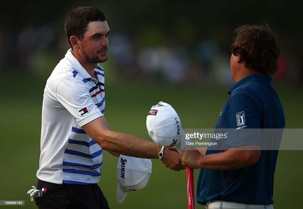 <a gi-track='captionPersonalityLinkClicked' href=/galleries/search?phrase=Keegan+Bradley&family=editorial&specificpeople=6388440 ng-click='$event.stopPropagation()'>Keegan Bradley</a> shakes hands with <a gi-track='captionPersonalityLinkClicked' href=/galleries/search?phrase=Jason+Dufner&family=editorial&specificpeople=561651 ng-click='$event.stopPropagation()'>Jason Dufner</a> after finishing the second round of the 2013 HP Byron Nelson Championship at the TPC Four Seasons Resort on May 17, 2013 in Irving, Texas.