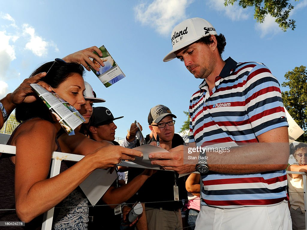 Keegan Bradley signs autographs for fans during the first round of the BMW Championship at Conway Farms Golf Club on September 12, 2013 in Lake Forest, Illinois.