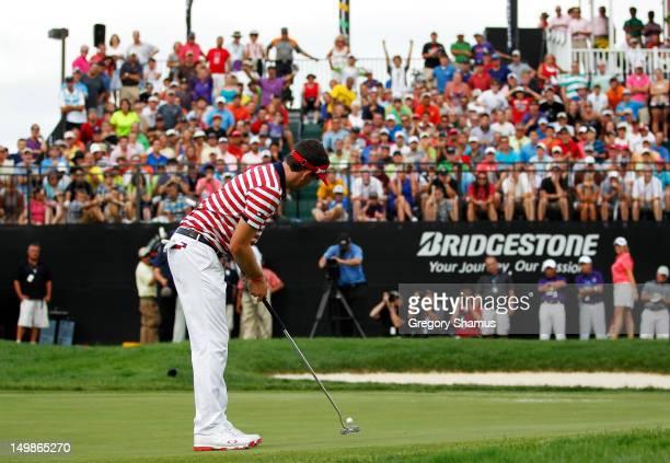 Keegan Bradley sinks his final putt for par on the 18th green on his way to winning the World Golf ChampionshipsBridgestone Invitational at Firestone...