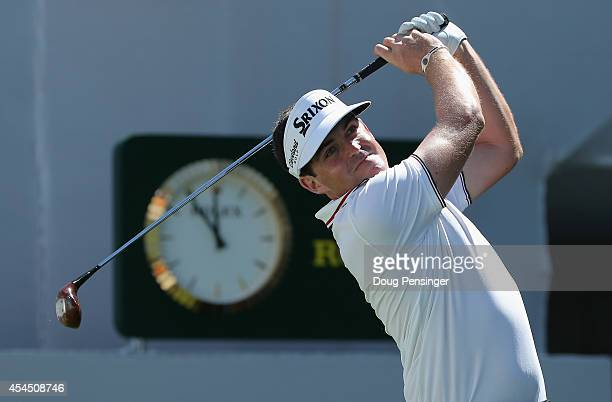 Keegan Bradley uses a vintage persimmon wood driver to hit a tee shot on the first hole during practice ahead of the BMW Championship at the Cherry...