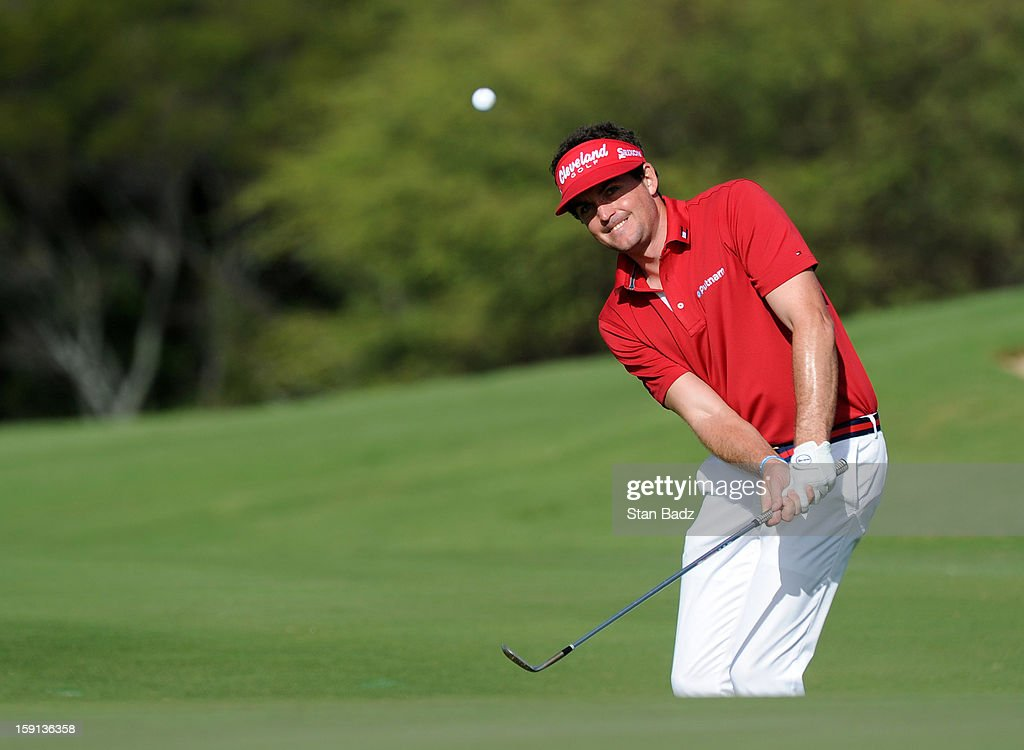 Keegan Bradley watches his chip shot on the ninth green during the final round of the Hyundai Tournament of Champions at Plantation Course at Kapalua on January 8, 2013 in Kapalua, Maui, Hawaii.