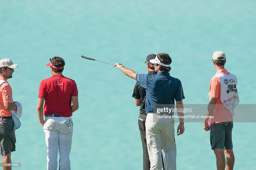 Keegan Bradley, Webb Simpson, and Bubba Watson of the US look out at the water on number 9 during the final round of play at The Port Royal Golf Club for the 30th Grand Slam of Golf on October, 24, 2012 in Southampton, Bermuda.