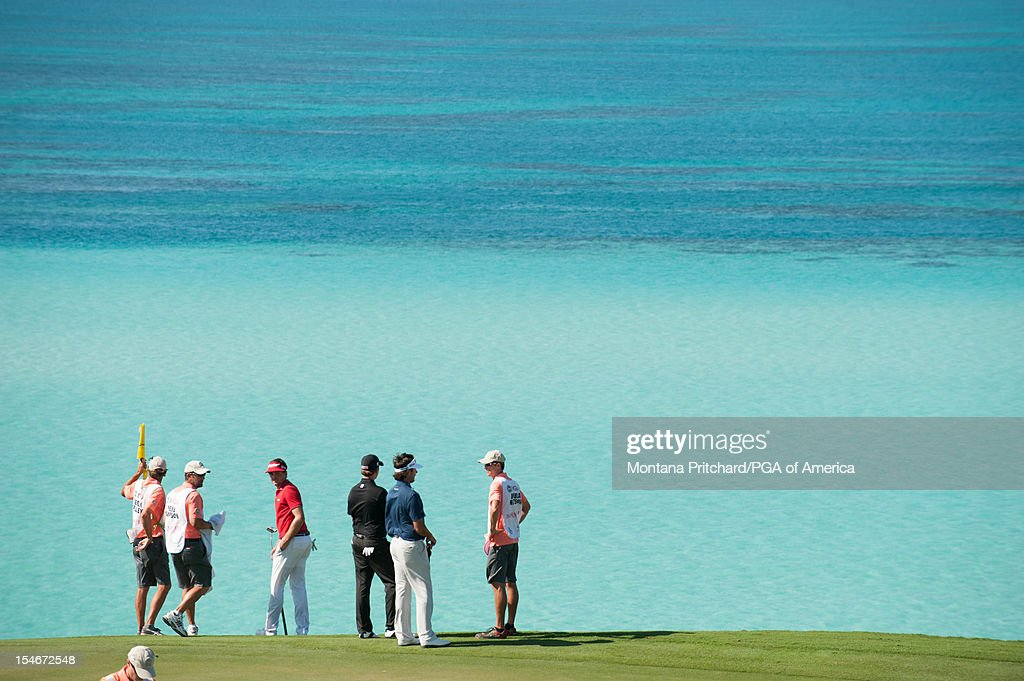 Keegan Bradley, Webb Simpson, and Bubba Watson stand on number 9 during the final round of play at The Port Royal Golf Club for the 30th Grand Slam of Golf on October, 24, 2012 in Southampton, Bermuda.