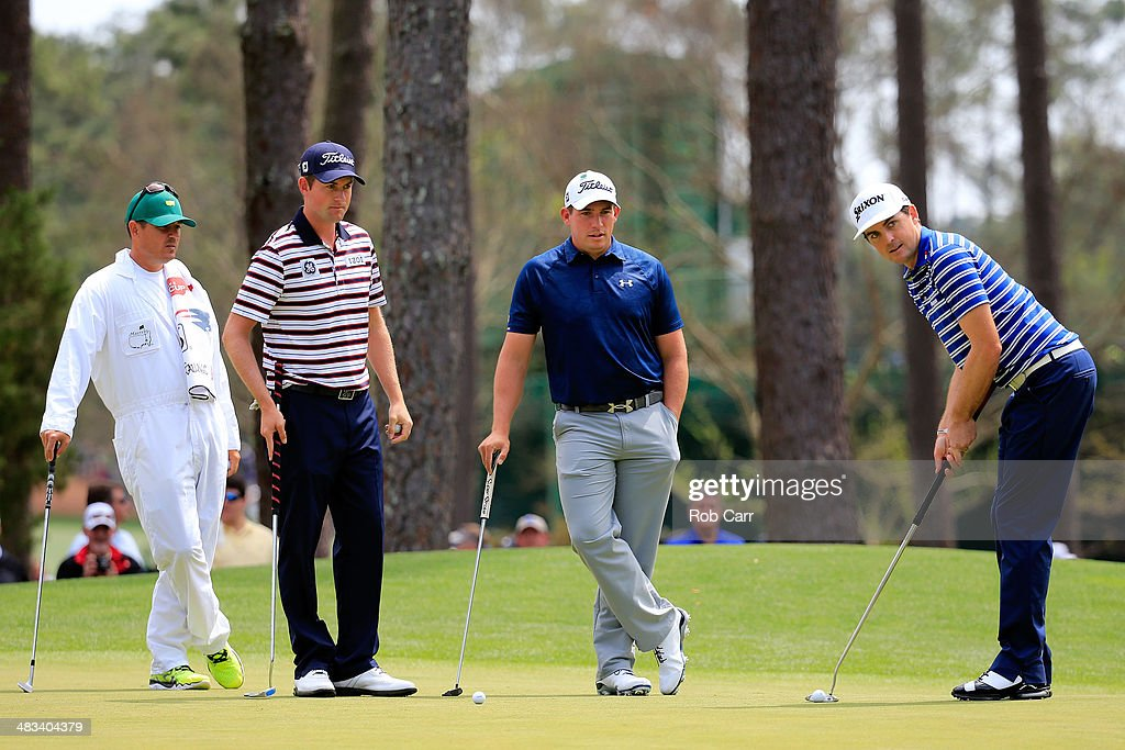 Keegan Bradley, Webb Simpson and Scott Stallings of the United States look over a green during a practice round prior to the start of the 2014 Masters Tournament at Augusta National Golf Club on April 8, 2014 in Augusta, Georgia.