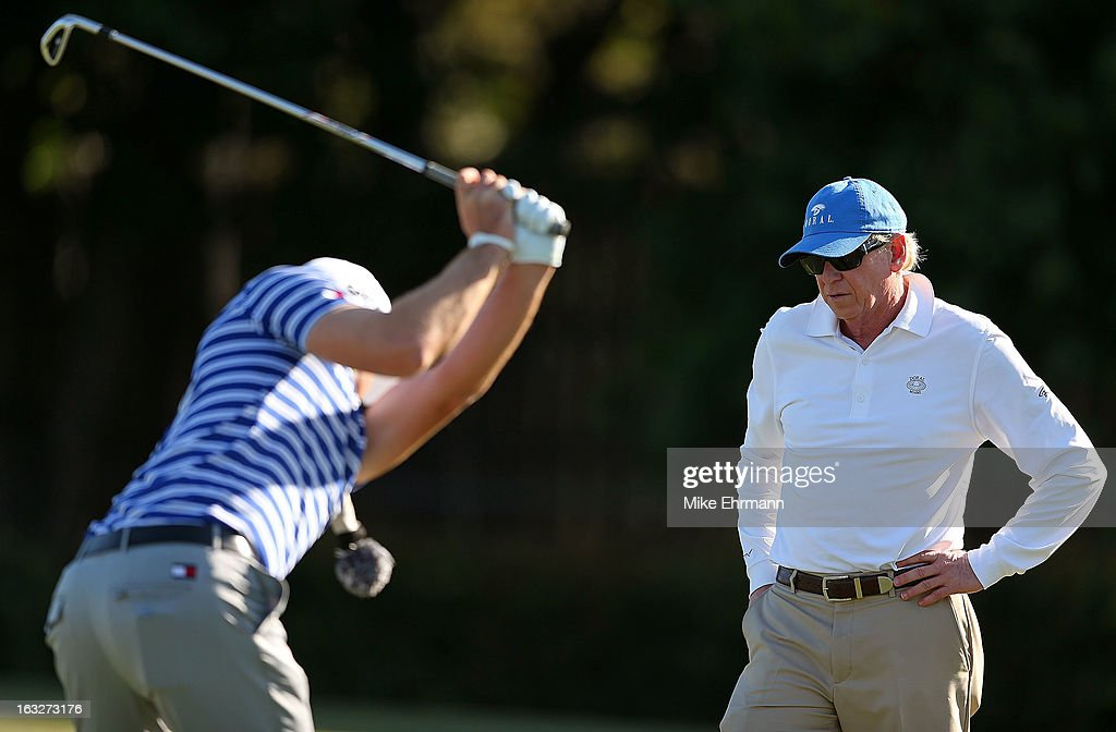 Keegan Bradley works out on the range with swing coach Jim McLean during a practice round for the WGC-Cadillac Championship at the Trump Doral Golf Resort & Spa on March 6, 2013 in Miami, Florida.