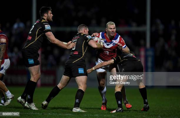 Keegan Hirst of Wakefield is tackled during the Betfred Super League match between Wakefield Trinity and Leigh Centurions at Belle Vue on March 23...