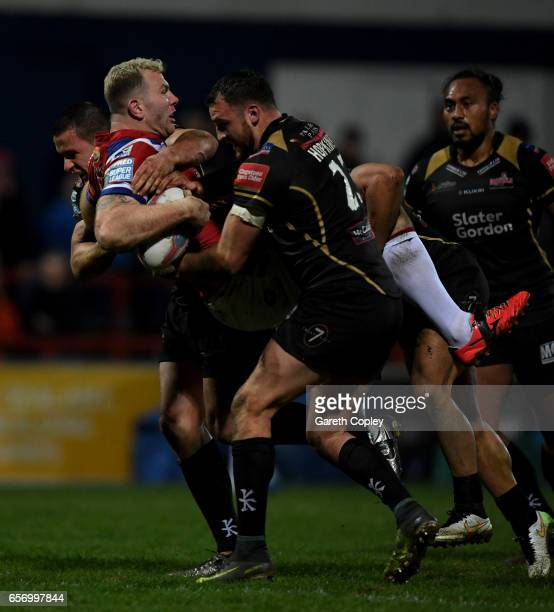 Keegan Hirst of Wakefield is tackled Sam Hopkins of Leigh during the Betfred Super League match between Wakefield Trinity and Leigh Centurions at...