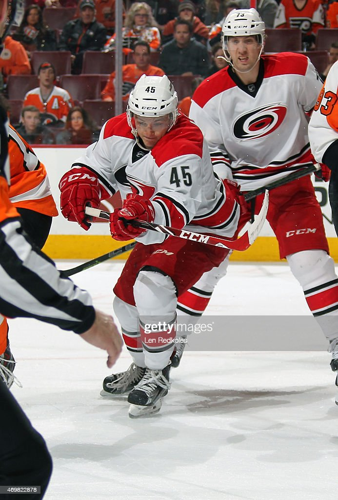 Keegan Lowe #45 of the Carolina Hurricanes making his NHL debut in action with teammate <a gi-track='captionPersonalityLinkClicked' href=/galleries/search?phrase=Brett+Bellemore&family=editorial&specificpeople=4270909 ng-click='$event.stopPropagation()'>Brett Bellemore</a> #73 against the Philadelphia Flyers on April 9, 2015 at the Wells Fargo Center in Philadelphia, Pennsylvania.