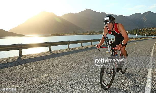 Keegan Williams of Cambridge rides along the lake Wanaka waterfront during Challenge Wanaka on January 18 2014 in Wanaka New Zealand