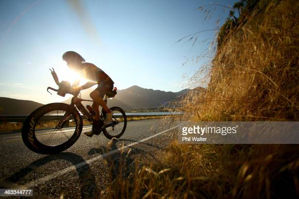 Keegan Williams of New Zealand rides alongside Lake Wanaka during the Challenge Wanaka on January 18 2014 in Wanaka New Zealand